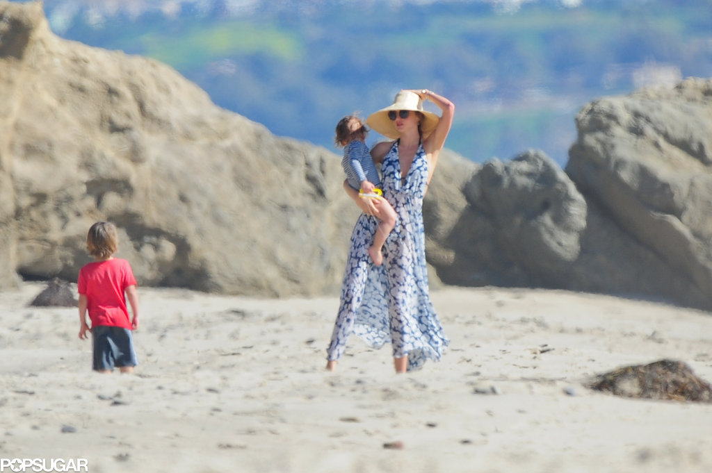 Miranda Kerr held Flynn in her arms on the beach in LA.