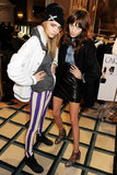 Cara Delevingne, clad in head-turning striped jeans, and Alexa Chung in a leather skirt, fooled around backstage at Mulberry.