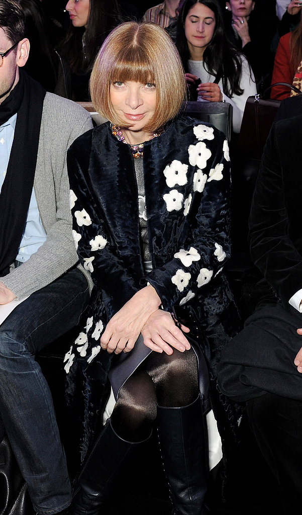 Anna Wintour kept cozy in her floral Prada coat while waiting for the Mulberry show to start.