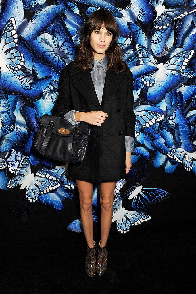 At Mulberry, Alexa Chung showed off her affinity for menswear-inspired styles in a shorts suit, metallic booties, and a midnight blue Mulberry bag from the A/W 2013 collection.