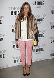 Olivia Palermo's pink printed pants injected feminine flavour to her white top and fur coat at Topshop Unique.