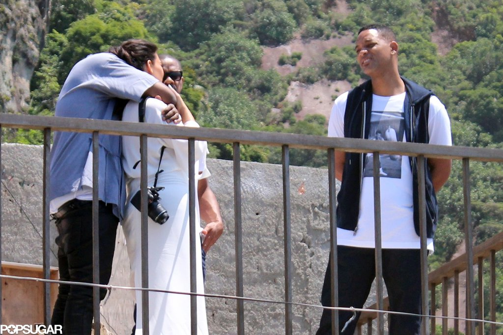 Kanye West hugged Kim Kardashian while touring Brazil with Will Smith.