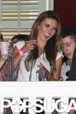 Audrina Patridge tossed handfuls of beads off a bar balcony in New Orleans during Super Bowl weekend 2013 in preparation for Mardi Gras.