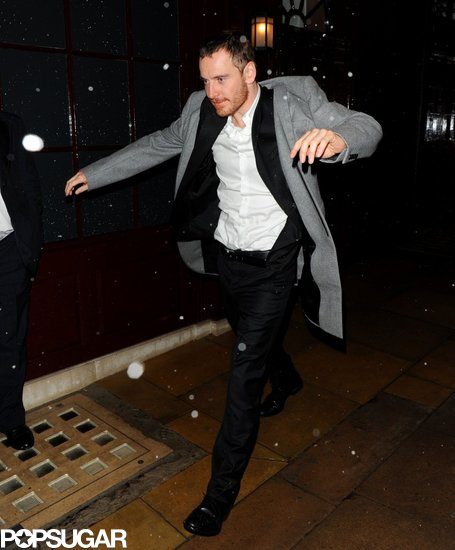 Michael Fassbender put on his coat while leaving a BAFTA Awards afterparty.
