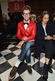 Brad Goreski took in the Tommy Hilfiger Fall '13 show in his signature mix of boyish-quirk pieces, including a bright red blazer, bow tie, and olive green lace-ups.