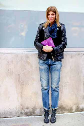 Grunge-chic in boyfriend jeans and an oversize biker jacket.