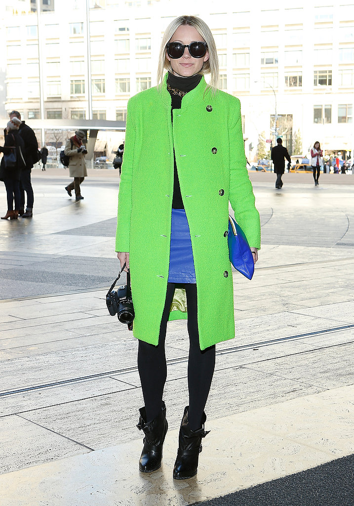 Blogger Blair Eadie decked out her black tights and turtleneck with a bold lime-hued coat and cobalt miniskirt.