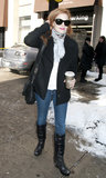 This time, Jessica Chastain paired her skinny jeans with a black double-breasted coat, black wedge rain boots, a printed scarf, and a black crossbody bag in NYC.