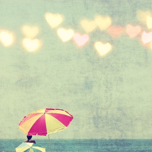 Heart-shaped bokeh details give this beach umbrella fine art photo ($30) a love-inspired twist.