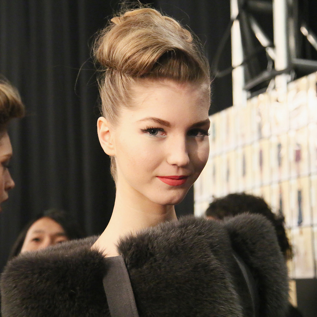 Once the curls were set, they were combed out and wrapped into a classic chignon shape for the Kim Novak look.