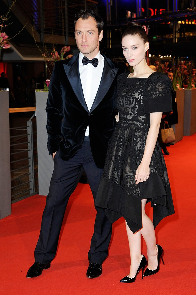 Costars Jude Law and Rooney Mara got close on the red carpet Tuesday night in Berlin.