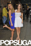 Sports Illustrated models Hannah Davis and Emily DiDonato posed together outside the studio.