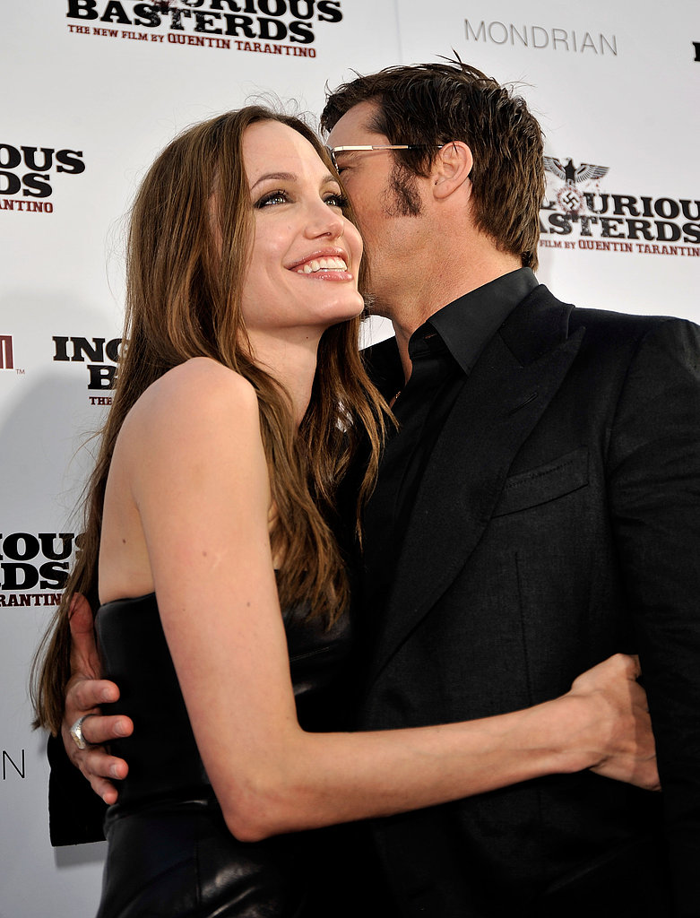 Brad and Angelina stayed close on the red carpet at the LA premiere of Inglourious Basterds in August 2009.
