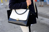 Céline's sleek black-and-white tote pops against any look.