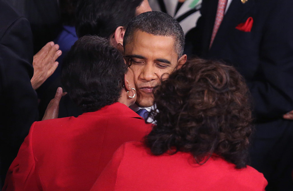 President Obama greeted legislators with a kiss.
