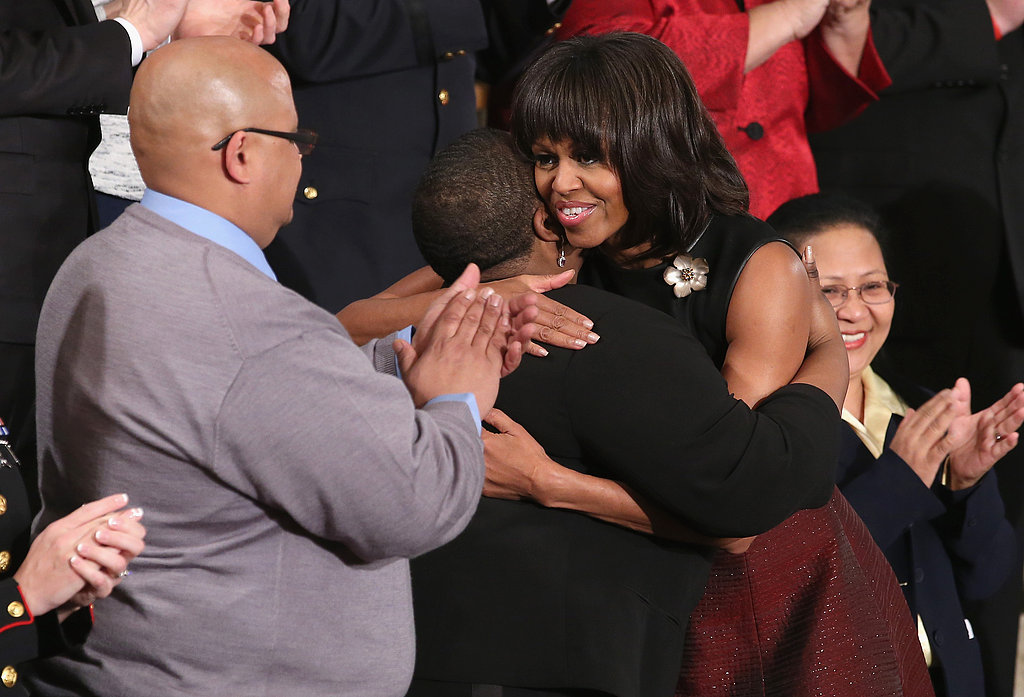 Fist Lady Michelle Obama hugged Cleopatra Cowley-Pendleton.