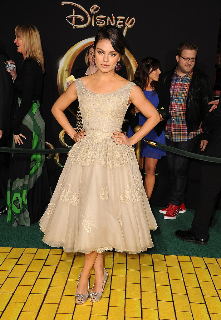 Mila Kunis took the fit-and-flare approach in a beige Dolce & Gabbana dress and Christian Louboutin peep-toes at the Oz the Great and Powerful premiere in LA.