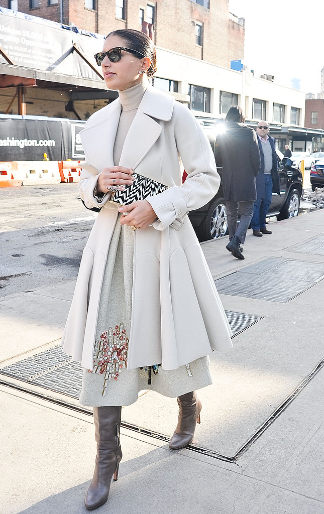 Creamy gray and white looked impossibly chic paired with posh boots on the streets outside the tents.