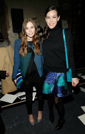Elizabeth Olsen and Liv Tyler posed together at the Proenza Schouler show on Wednesday.