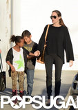 Angelina Jolie held hands with her daughter Zahara during a shopping trip to Urban Outfitters with Pax in LA in February.