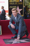 Simon Baker posed with his Hollywood star at his Walk of Fame ceremony on Thursday in Hollywood.