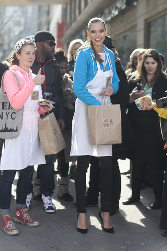Karlie looked totally adorable passing out cookies around Milk Studios.