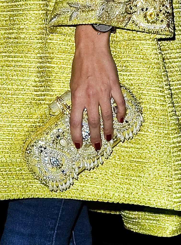 We love this over-the-top embellished citron clutch.