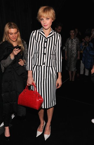 Jessica Stam sported a striped skirt suit with white pumps and a red bag at Marc Jacobs.