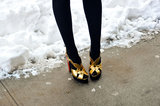 Gold heels contrasted beautifully against black tights.