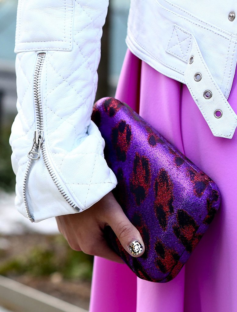 We love the wild animal print on this metallic purple clutch.