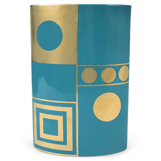 Snag a similar look with a teal-and-gold vase ($125) that also mixes color and pattern.