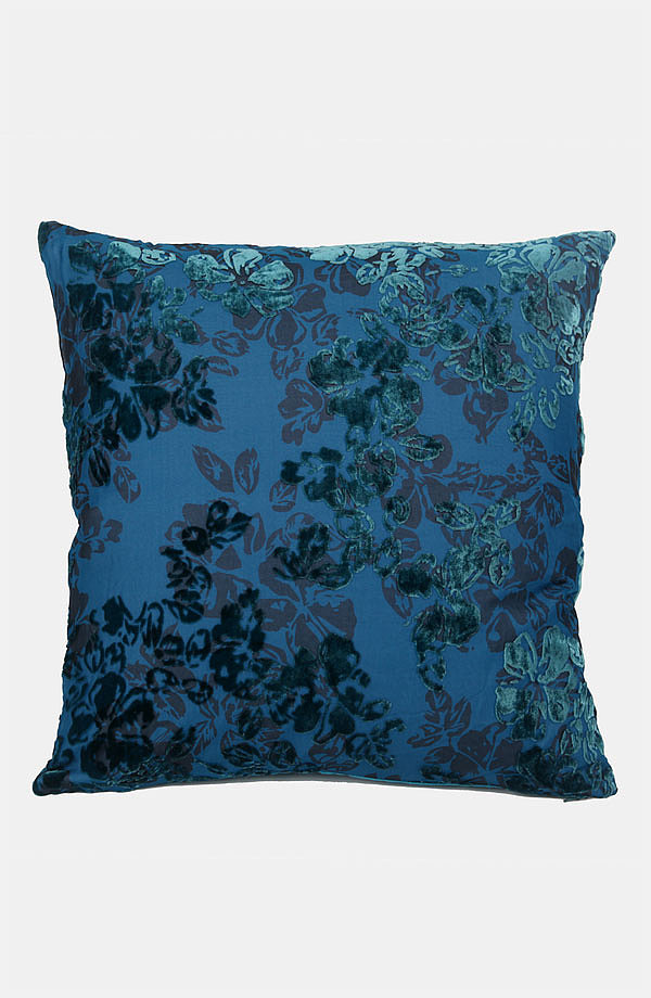 The soft shine of this velvet floral pillow ($75) will bring a pop of color to your couch or bed.