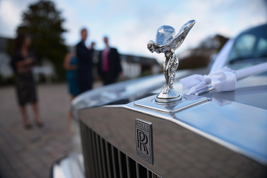 A Rolls-Royce was parked outside the venue for one of the newlywed couples.