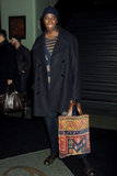 J. Alexander held onto a patterned tote.