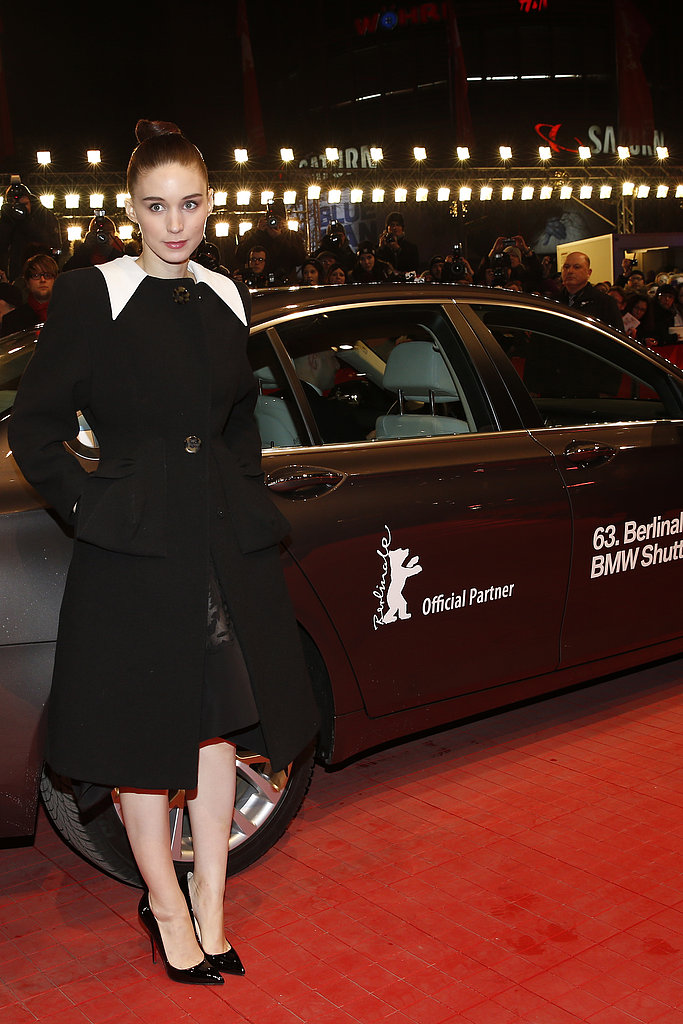 At the Side Effects premiere in Berlin, Rooney Mara covered up her dress in a black and white coat right before heading inside.