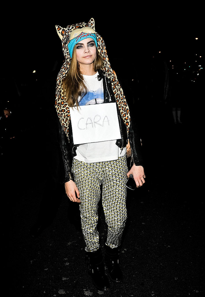 Cara Delevingne showed off her quirky head gear outside the Marc Jacobs show.