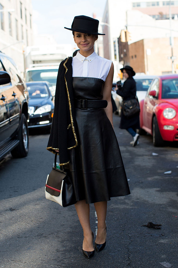 Miroslava Duma gave a sweetness to her leather dress with a little white blouse, classic heels, and a structured bag.