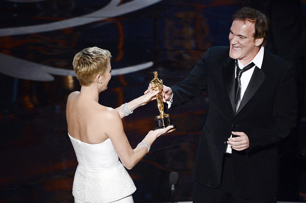 Charlize Theron presented an award to Quentin Tarantino at the 2013 Oscars.