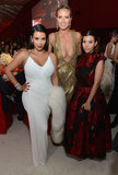 Heidi Klum posed with a pregnant Kim Kardashian and Kourtney Kardashian at Elton John's party.