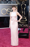 Anne Hathaway stepped out in a pale pink Prada gown for the Oscars.