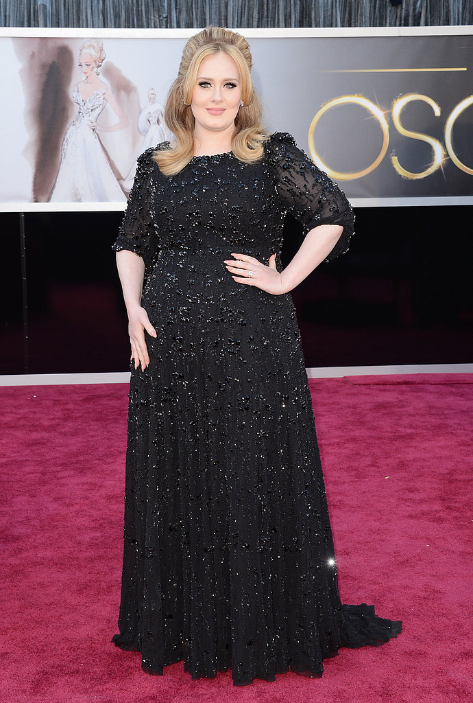 Adele wore an embellished black dress on the Oscars red carpet.