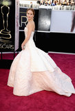 Jennifer Lawrence showed off the train of her Dior gown on the Oscars red carpet.