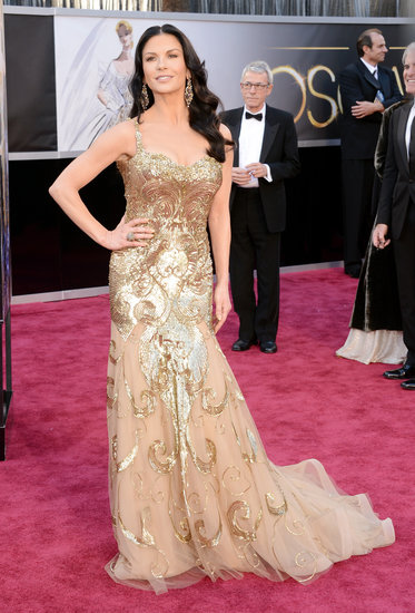 Catherine Zeta-Jones, mom to Carys and Dylan, wore a gold Zuhair Murad gown on the red carpet at the Oscars 2013.