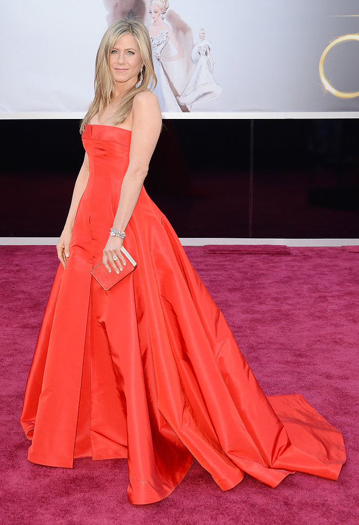 Jennifer Aniston looked stunning in a bright red Valentino number.