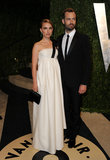 Natalie Portman and Benjamin Millepied posed at the Vanity Fair Oscars bash.
