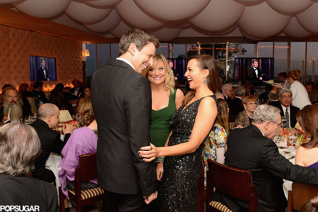 Rashida Jones giggled while she chatted with Seth Meyers and Amy Poehler at the Vanity Fair party.