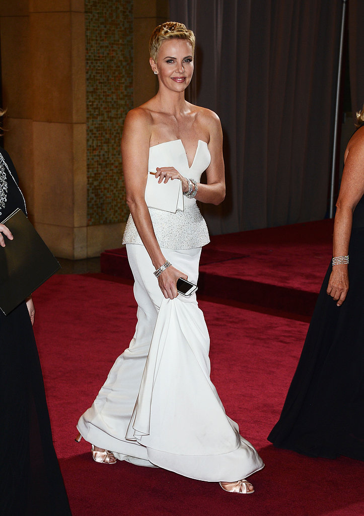 Charlize Theron smiled as she left the Oscars.