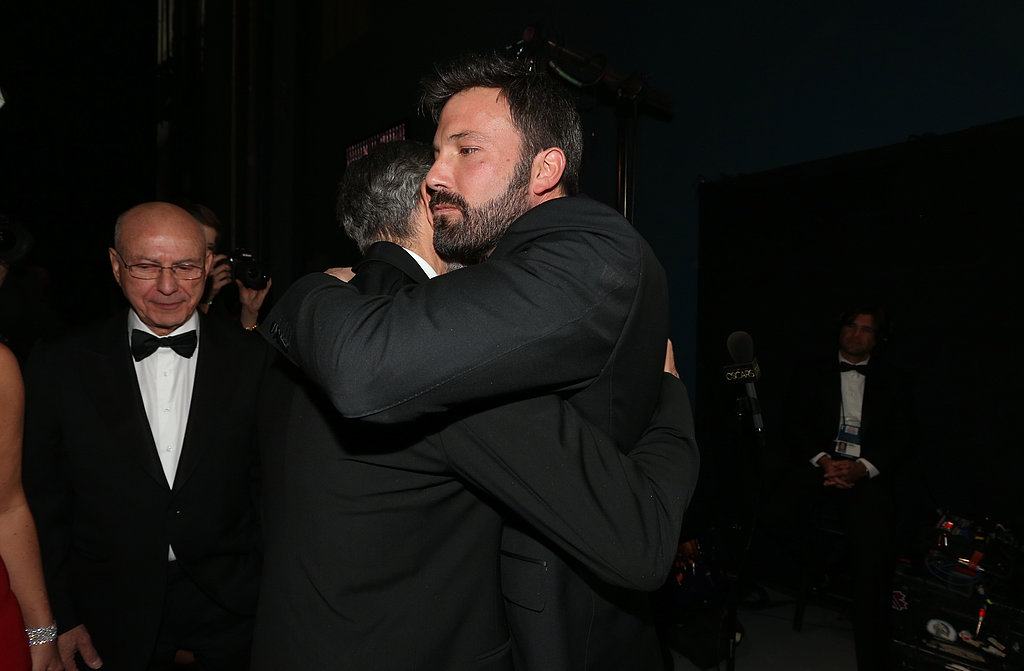 Ben Affleck and George Clooney hugged backstage at the 2013 Oscars.