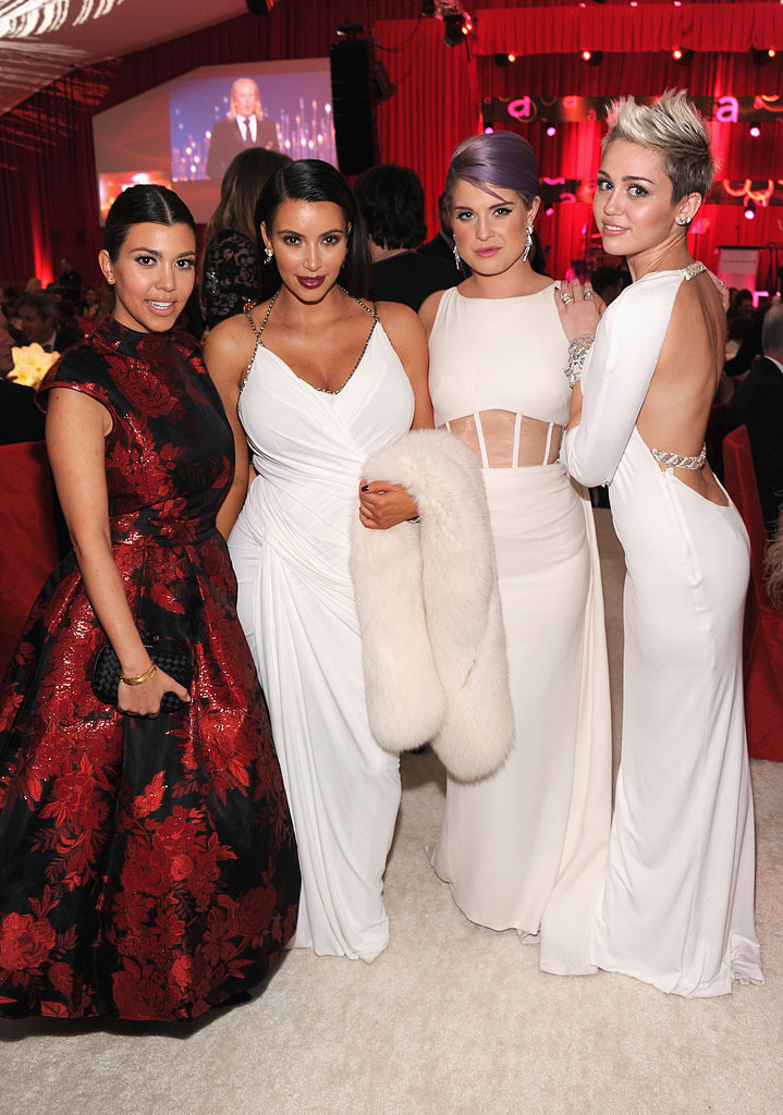 Miley Cyrus hung out with Kelly Osbourne, Kim Kardashian, and Kourtney Kardashian at Elton John's party on Oscar night.