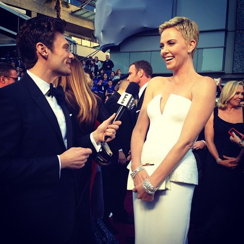 Charlize Theron glowed while talking to Ryan Seacrest on the red carpet. Source: Instagram user ryanseacrest